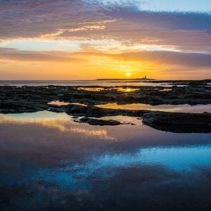 Coquet Island Sunrise is a limited edition framed print