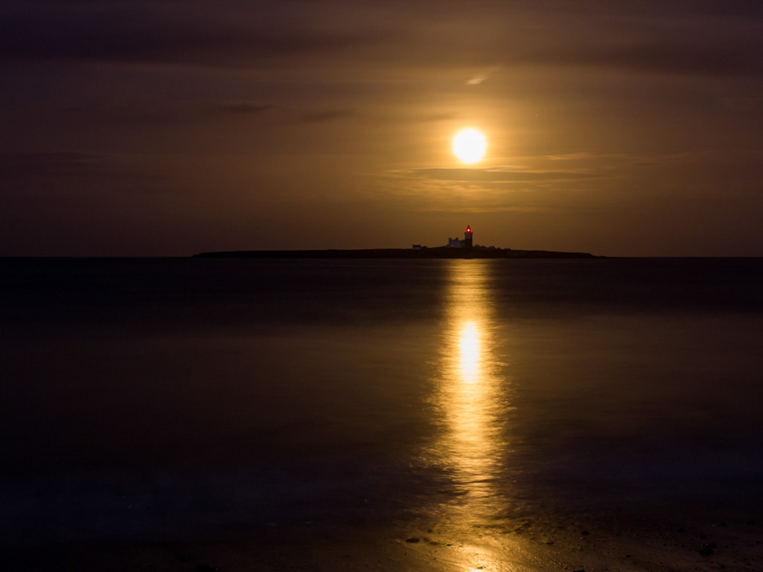 Golden Moon rising behind Coquet Island