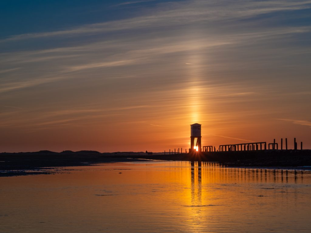 sunrise on Lindisfarne causeway. A much newer camera and a professional quality lens that I bought second hand but later had to get repaired after the aperture blades started sticking.