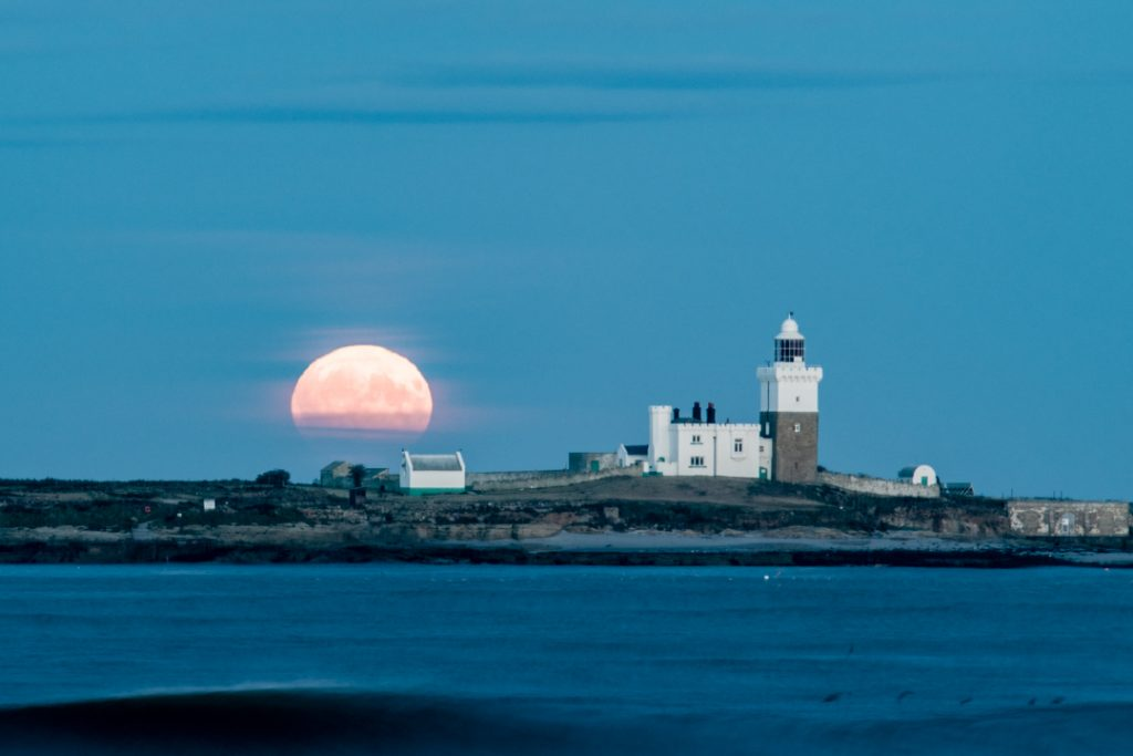 Moonrise behind coquet island shot entirely in manual mode.