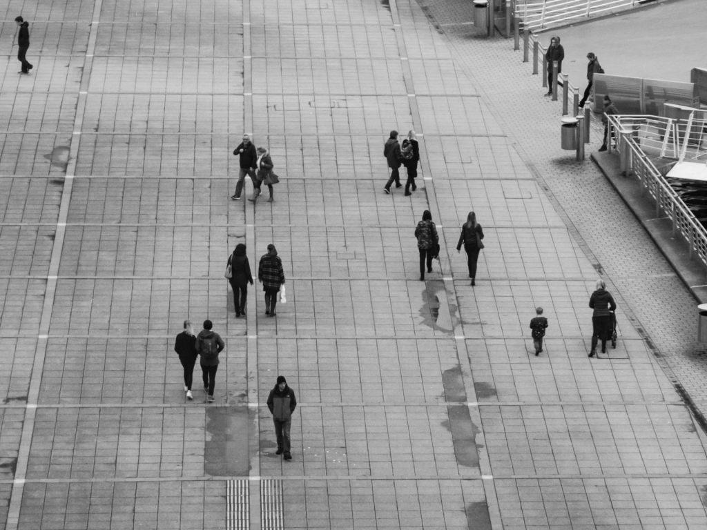A birds eye view of people walking in the street.