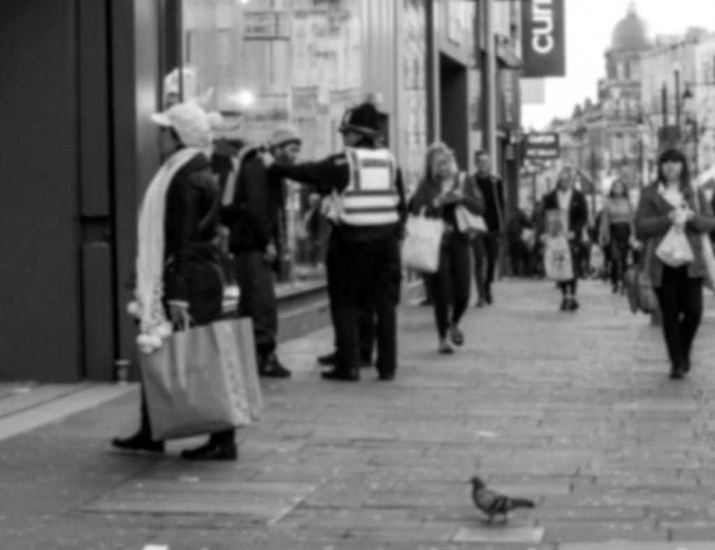 Blurred image of an arrest. Street Art Photography telling a story.