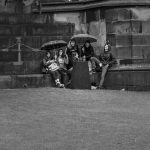 a group of young people in the rain