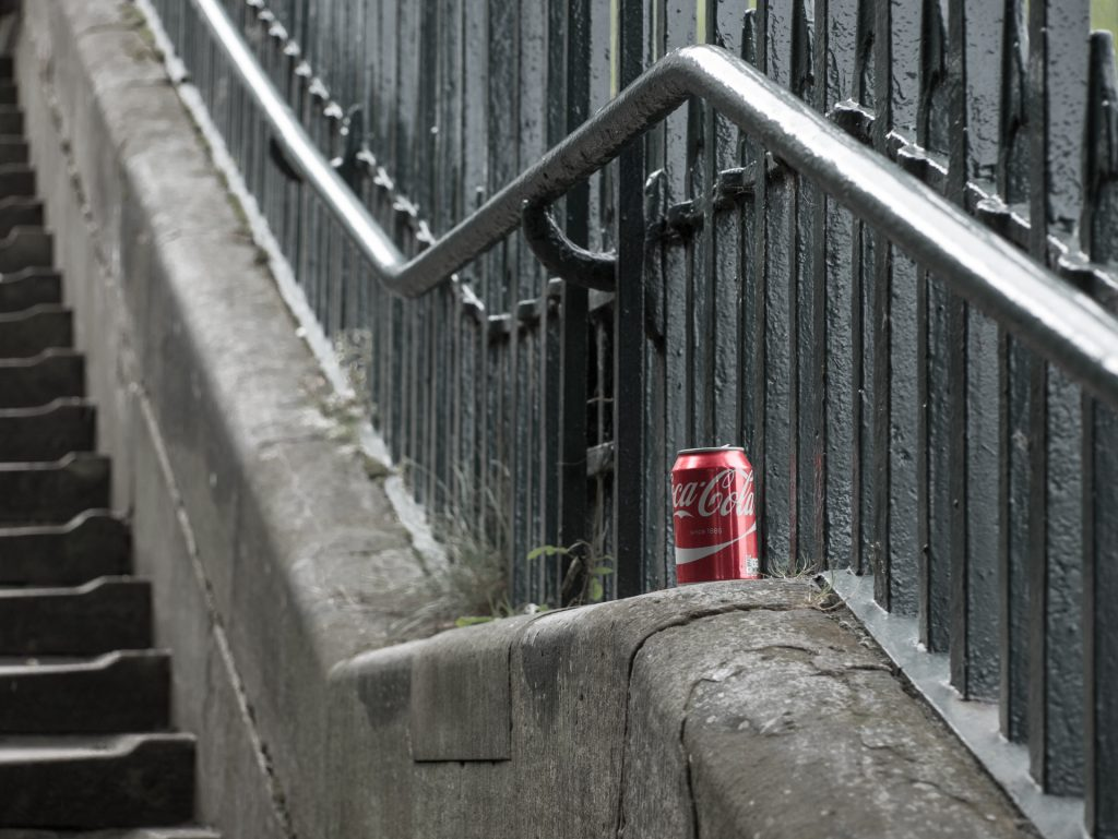Fall: A Coke can littering steps