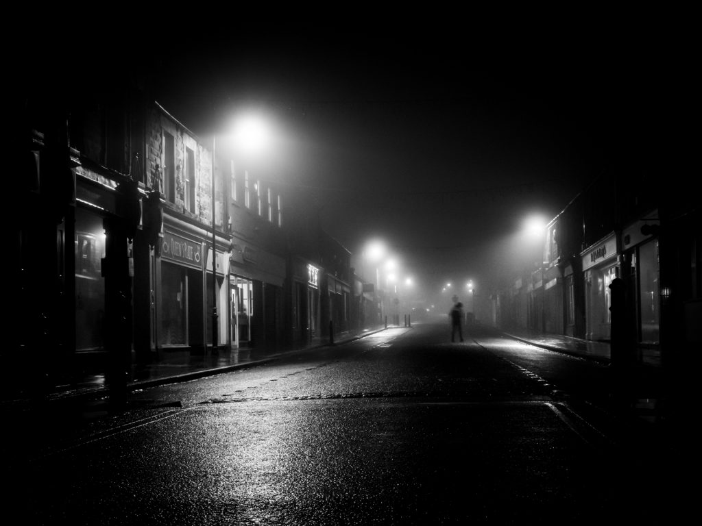 Imposter! Night scene of a street in black and white