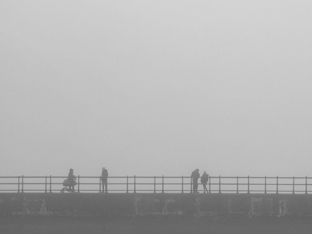 people passing in the mist