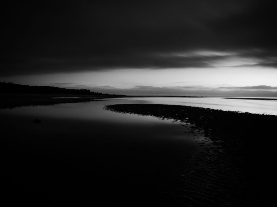 Dawn image of the beach in monichrome