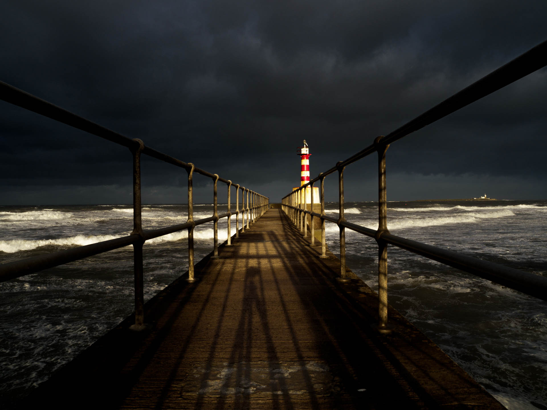 Coquet Storm - Website image of the end of Amble Pier and Coquet island